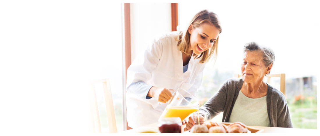 caregiver serving meal to her patient
